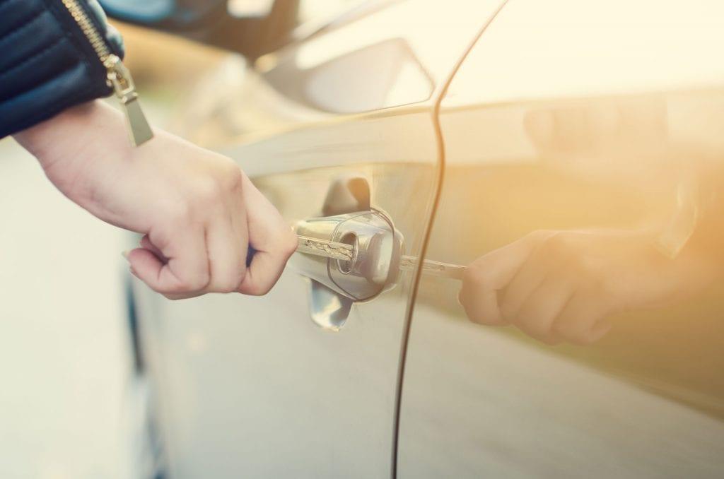 woman locking car to decreased car theft chances