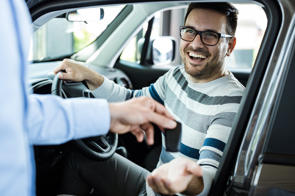 man getting new car with remote starter